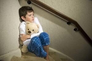 Anxoius boy with the Teddy